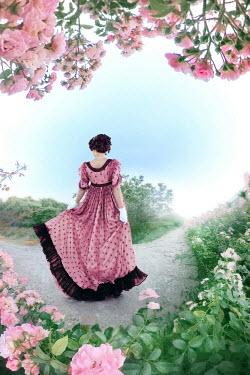 ILINA SIMEONOVA Regency woman in pink dress walking in garden