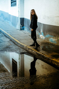 Shelley Richmond Young woman walking by puddle