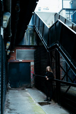 Shelley Richmond Young woman standing in alley