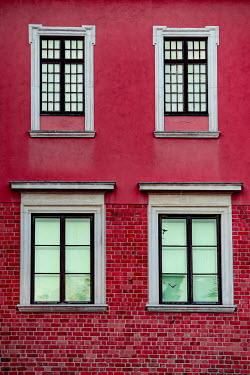 Magdalena Wasiczek Windows of red apartment building