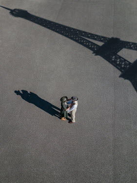 Magdalena Russocka retro copuple standing on sunlit pavement with shadow of eiffel tower from above