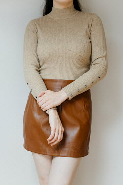 Shelley Richmond 1960s young woman in sweater and leather skirt