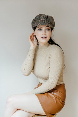 Shelley Richmond 1960s young woman in hat, sweater, and leather skirt