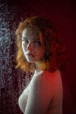 Natasza Fiedotjew young woman behind wet glass