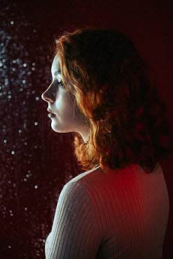 Natasza Fiedotjew profile of young woman behind wet glass
