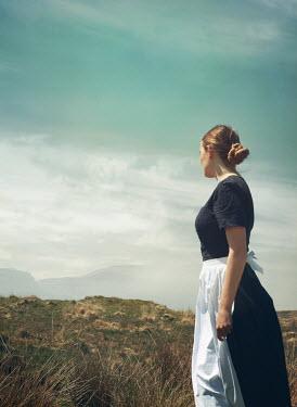 Mark Owen Young woman in apron in field