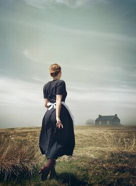 Mark Owen Woman in field walking to house