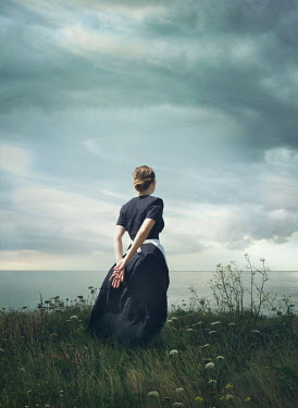 Mark Owen Young woman in field by sea