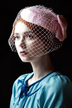 Natasza Fiedotjew young vintage woman in blue dress and pink fascinator