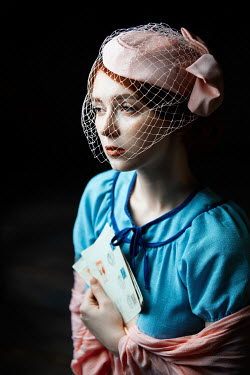 Natasza Fiedotjew young vintage woman in fascinator and shawl holding letters