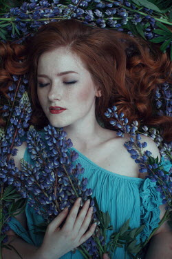 Irina Orwald Young woman lying with flowers