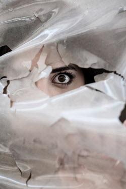 Mohamad Itani WOMAN HIDING BEHIND TORN PLASTIC