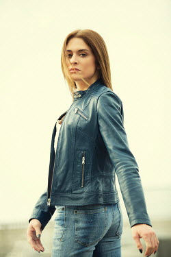 Mohamad Itani SERIOUS BRUNETTE WOMAN IN LEATHER JACKET OUTDOORS