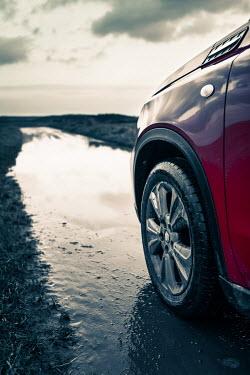 Magdalena Russocka close up of car on muddy country road