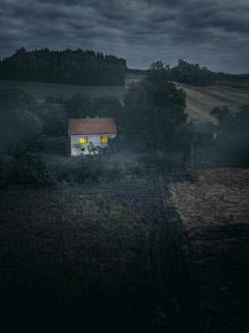 Magdalena Russocka lights in windows of old cottage house at dusk from above