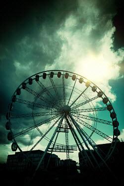Magdalena Russocka big ferris wheel against stormy sky