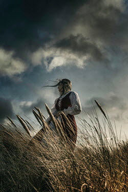 Nic Skerten WINDSWEPT HISTORICAL WOMAN WITH STORMY SKY