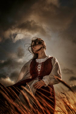 Nic Skerten MEDIEVAL WOMAN IN WINDY STORMY COUNTRYSIDE