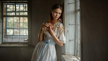 Georgy Chernyadyev GIRL DAYDREAMING BY WINDOW IN OLD HOUSE