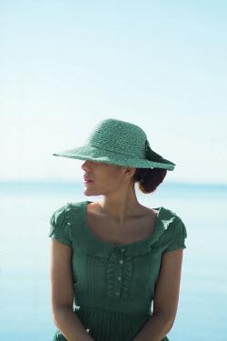 Ildiko Neer Young woman sitting by sea