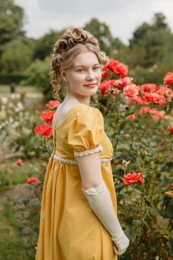 Shelley Richmond BLONDE REGENCY WOMAN STANDING IN ROSE GARDEN