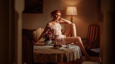 Georgy Chernyadyev GIRL WITH RED HAIR SITTING ON TABLE IN HOUSE