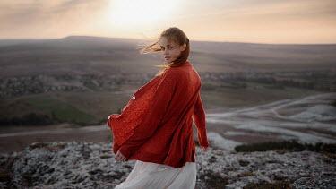 Georgy Chernyadyev GIRL TURNING ON HILL IN WINDY LANDSCAPE