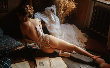 Georgy Chernyadyev WOMAN LYING INDOORS IN CORSET WITH WHITE DRESS