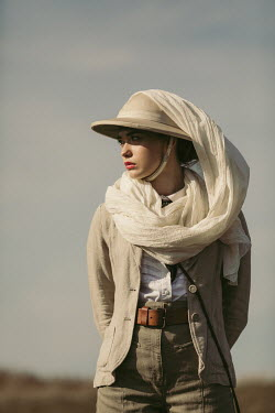 Magdalena Russocka close up of young woman wearing safari outfit standing in field