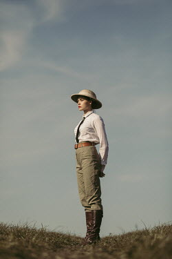 Magdalena Russocka young woman wearing safari outfit standing in field