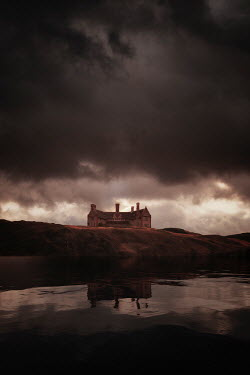 Nic Skerten OLD MANSION BY WATER WITH STORMY SKY