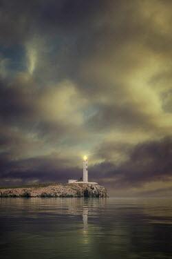 Nic Skerten LIGHTHOUSE SHINING BY CALM SEA
