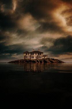 Nic Skerten LARGE HOUSE ON ISLAND AT DUSK