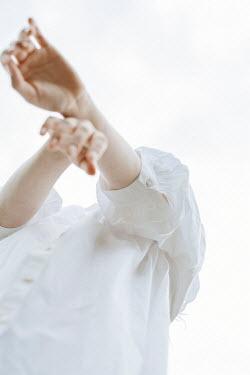 Shelley Richmond WOMAN IN WHITE DRESS OUTSIDE FROM BELOW
