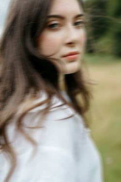 Shelley Richmond SERIOUS BRUNETTE WOMAN IN COUNTRYSIDE