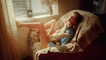 Georgy Chernyadyev WOMAN SITTING CUDDLING CAT INDOORS