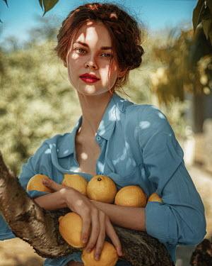 Georgy Chernyadyev WOMAN HOLDING LEMONS IN SUNLIT GARDEN