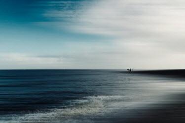 Dirk Wustenhagen DISTANT FAMILY ON BEACH WITH BLUE SKY