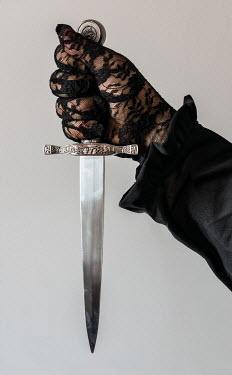 Jaroslaw Blaminsky FEMALE HAND IN LACE GLOVE HOLDING DAGGER