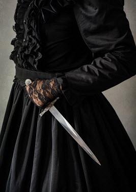 Jaroslaw Blaminsky VICTORIAN WOMAN IN BLACK HOLDING DAGGER
