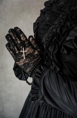 Jaroslaw Blaminsky VICTORIAN WOMAN IN BLACK HOLDING ROSARY