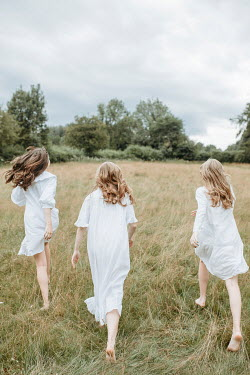 Shelley Richmond THREE WOMEN IN WHITE WALKING IN FIELD