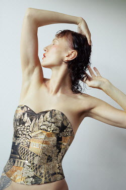 Marta Bevacqua WOMAN WITH RAISED ARMS IN PATTERNED BODICE