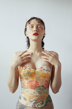 Marta Bevacqua WOMAN WITH CLOSED EYES IN PATTERNED BODICE
