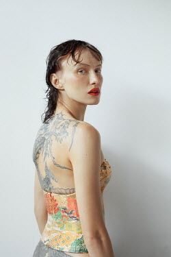 Marta Bevacqua WOMAN IN PATTERNED BODICE WITH TATTOOS