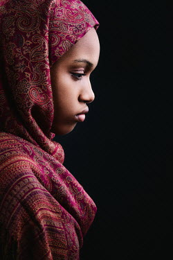 Magdalena Russocka close up of african woman wearing headscarf inside
