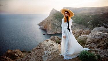 Georgy Chernyadyev WOMAN IN HAT ON CLIFFS WATCHING SEA