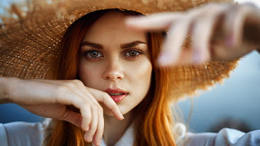 Georgy Chernyadyev SERIOUS WOMAN WITH RED HAIR IN STRAW HAT