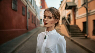 Georgy Chernyadyev WOMAN WITH VEIL STANDING IN STREET