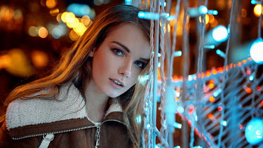 Georgy Chernyadyev GIRL WITH LONG BROWN HAIR IN COAT BY FAIRY LIGHTS